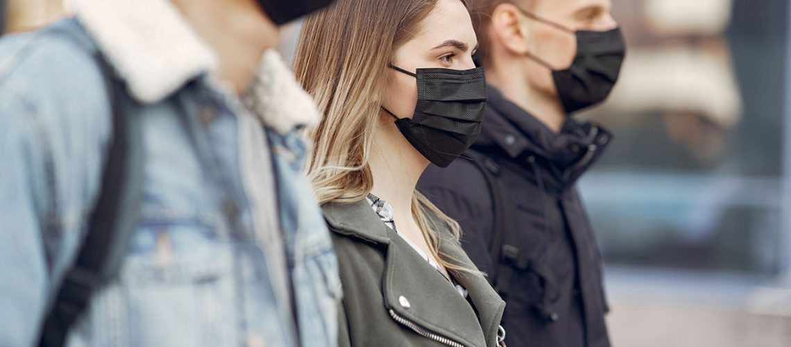people-in-a-masks-stands-on-the-street-CG9BYQF